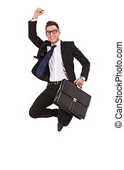 business man with briefcase jumping - Excited business man...