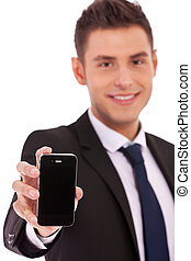 buiness man shows a smartphone