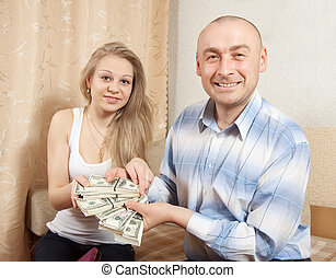 Happy family with many US dollars - Happy young family with...