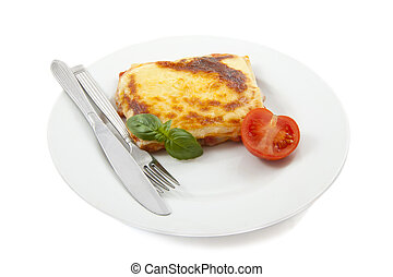 Lasagna - White plate with lasagna isolated over white
