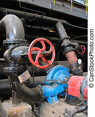 red valve and electric water pumps at power plant - red...