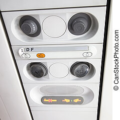 Detail of airplan interior salon. Overhead buttons