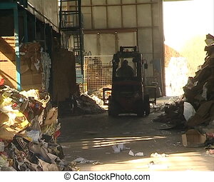 paper recycling tractor - paper and polythene recycling....