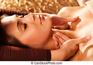 neck and face massage - woman getting neck and face massage...