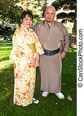 Kimonos - Man and woman in traditional Japanese outfits