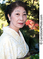 Kimono - Mature woman in a traditional Japanese outfit