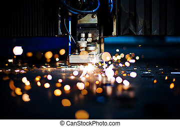 Laser close-up - Laser cutting with sparks close up