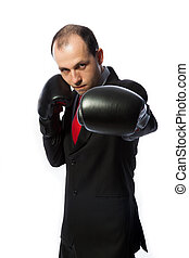 Businessman with boxing gloves in fighting stance punching