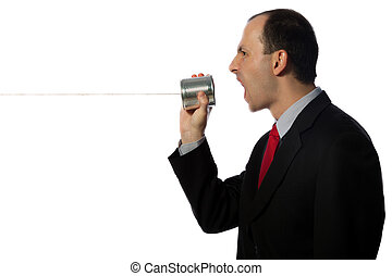 Businessman yelling through an oldschool can phone,...