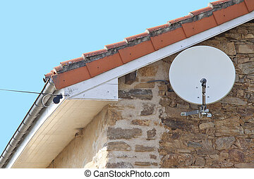 Satellite dish - Satelite dish close up on the wall near the...