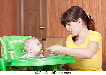 Mother feeding her 6 month  baby