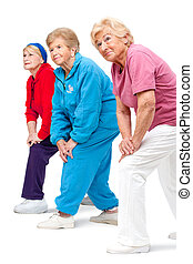 Senior women streching legs. - Threesome group of senior...