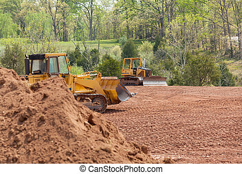 Large earth mover digger clearing land - Land being levelled...