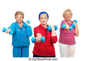 Three senior women doing workout. - Three healthy senior...