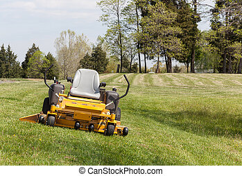 Zero turn lawn mower on turf with no driver - No person on...