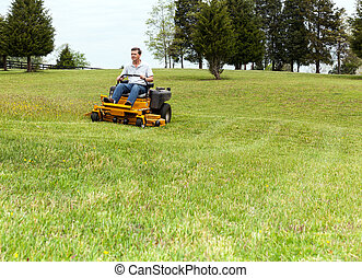 Senior man on zero turn lawn mower on turf - Senior retired...