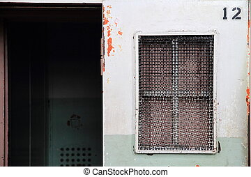 Cellblock at Alcatraz closeup view, window and door
