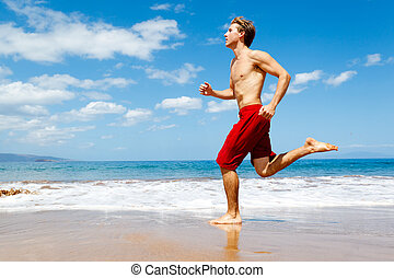 Runner on Beach - Physically fit man running on Beach