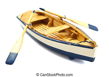 Row boat - Wooden boat with paddles isolated over white