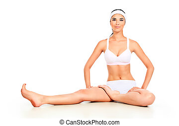 flexible - Shot of a sporty young woman doing yoga exercise...