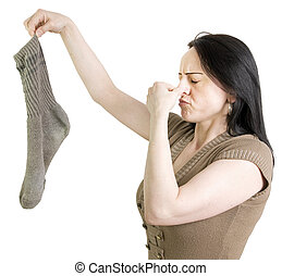 woman with dirty sock holding her nose on a white background
