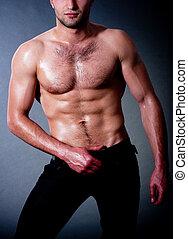 Fashionable muscular man