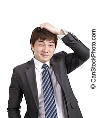 Embarrassment asian businessman