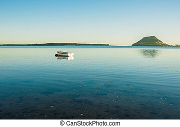 Small boat on water. - Small boat floating on Tauranga...