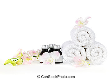 Rolled up spa towels - White rolled up spa towels and body...