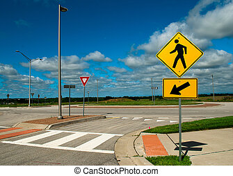 Pedestrian crossing - Sign in the street on a blue sky day.
