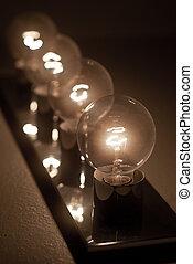Lightbulbs - four lightbulbs on, in a row
