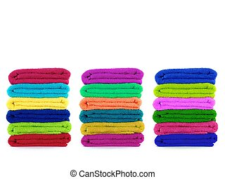 Towels - Colored towels isolated against a white background