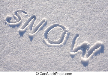 text SNOW on the snow - writing text SNOW in sunny day on...