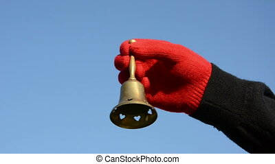 vintage brass bell in the hand