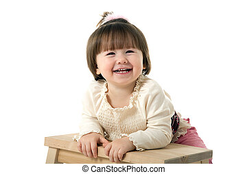 little  girl on a chair
