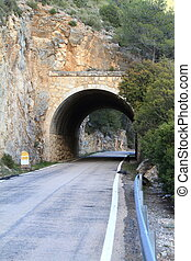 Stone tunnel at mountain road - Short Stone tunnel at...