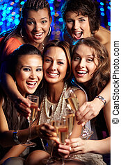 Party in full swing - Vertical shot of girls having fun at...