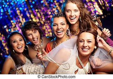 Bride having fun - Group shot of young women celebrating...