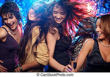 Ecstatic - Young women having fun dancing at nightclub