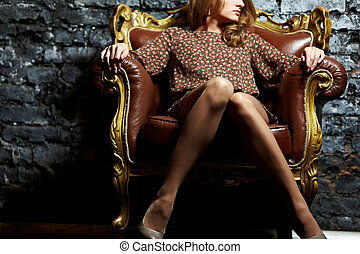 Model in armchair