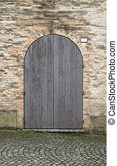 wooden door with brick wall