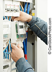 Close-up Electrician hands installing energy meter -...