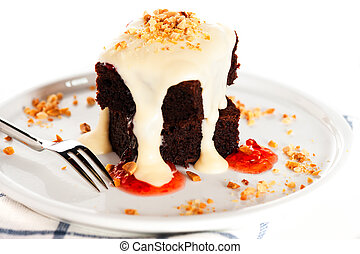 A plate with 2 pieces brownies white chocolate peanuts and...