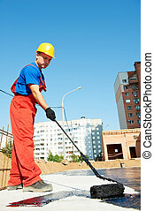 builder worker at roof insulation work - builder worker in...