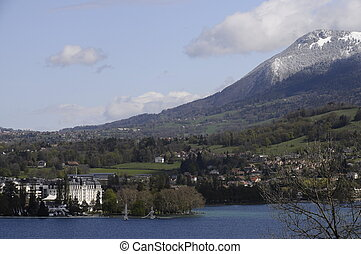 Annecy - View of Annecy city and lake with snowed mountains,...
