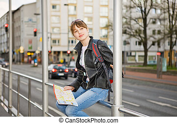 woman with city map in hands