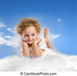 little girl with fairy wings lies on a cloud - little girl...