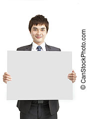smiling asian business man holding empty board