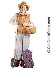 woman  with spade and harvested potato