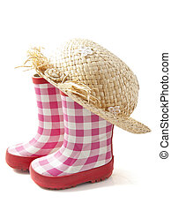 Seasonal clothing - Rubber boots with straw head isolated...